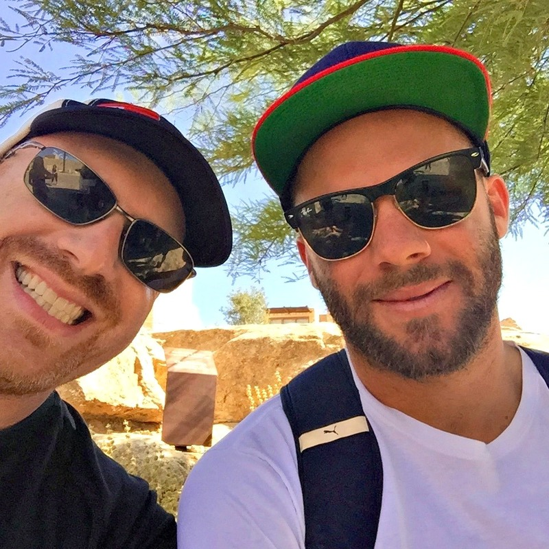 Dan Seligson, left, with the Patriots' Julian Edelman in Israel last year