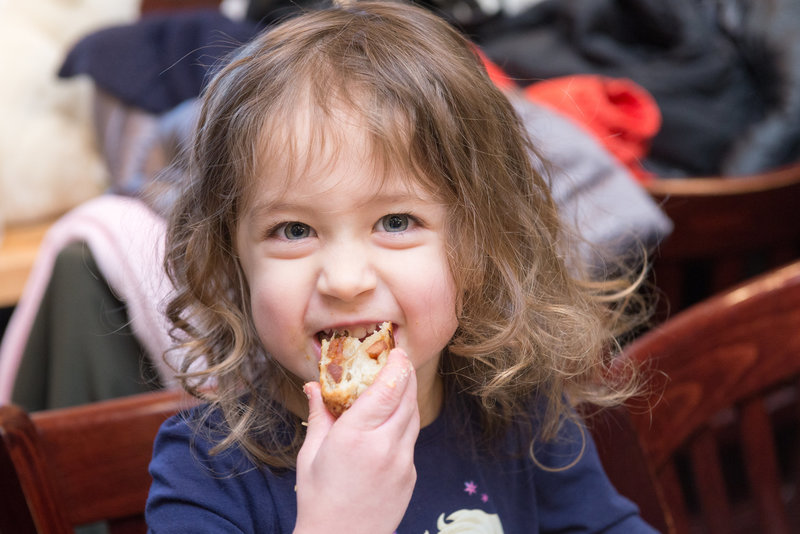 Three-year-old Dalya samples a knish from Michael's Deli (Photo credit: Jordyn Rozensky Photography)