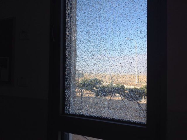 Shattered glass caused by the rocket hitting a residential home